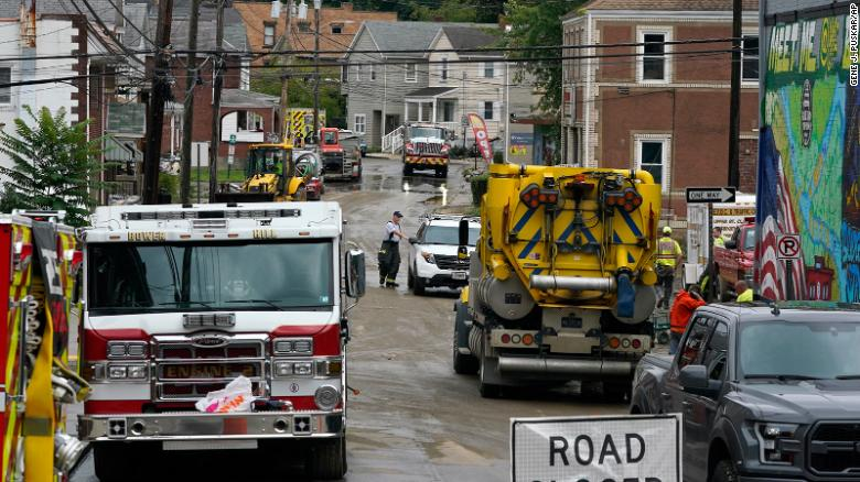 Workers clear a road from flooding in Bridgeville, Pennsylvania, on September 1.