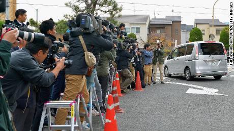 A car carrying Chisako Kakehi leaves the police station on November 20, 2014, in Muko, Japan.