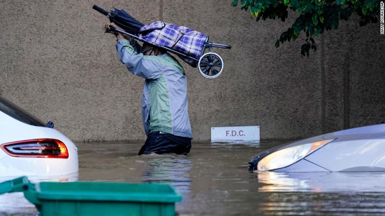 A person walks in floodwaters in Philadelphia on September 2.