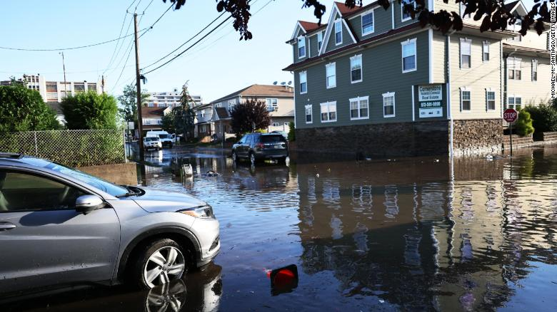A car left behind in the floodwaters of Passaic, New Jersey.