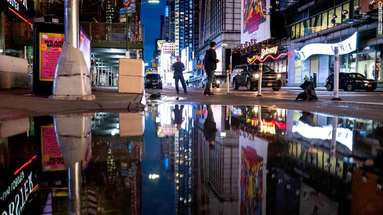 The lights of Times Square in New York are reflected in standing water Thursday, September 2, 2021, as Hurricane Ida left behind not just water on city streets but wind damage and severe flooding along the Eastern seaboard.