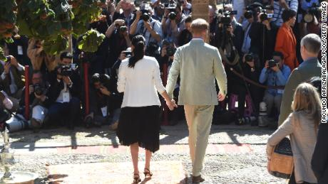 The Sussexes walk towards the media outlets traveling with them during their Morocco visit in 2019.
