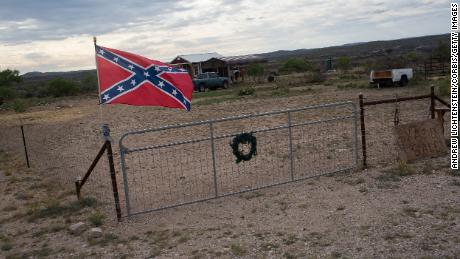 A Confederate flag flies outside of a home on April 17, 2021, in Langtry, Texas.