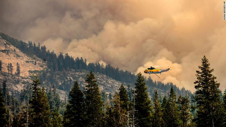 A helicopter flies over Wrights Lake while battling the Caldor Fire in California's Eldorado National Forest on Wednesday, September 1.