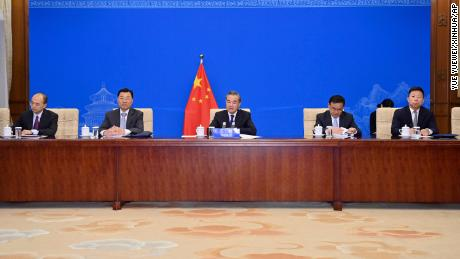 Chinese Foreign Minister Wang Yi, center, and other officials meeting with Kerry via videolink on Wednesday.
