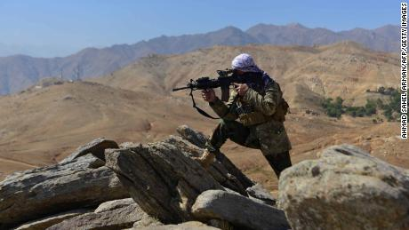 An anti-Taliban fighter takes a position during a patrol on a hilltop in Darband area in Anaba district, Panjshir province on September 1.