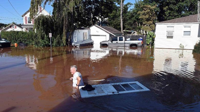 A man wades through floodwaters in Manville, New Jersey, on September 2.