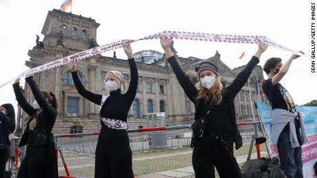 Abortion rights activists in Berlin form a human chain in front of the German parliament building in May.