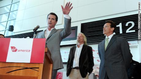 Then-San Francisco Mayor Gavin Newsom, Sir Richard Branson and then-California Gov. Arnold Schwarzenegger speak at a ribbon cutting in 2010 in San Francisco.