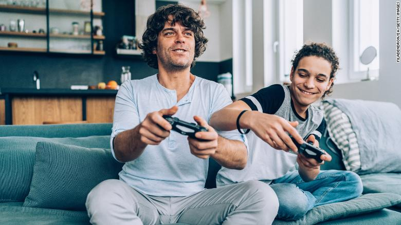 Play video games together at home.