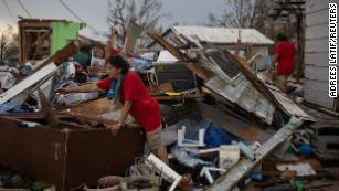 New Orleans is transporting some residents to shelters as hundreds of thousands remain without power after Hurricane Ida