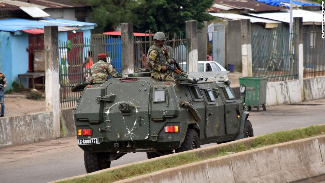 Guinean military officer says President Alpha Conde arrested, as apparent coup unfolds - CNN