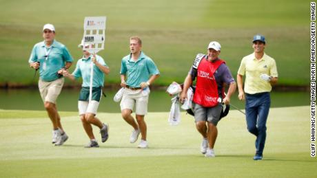 Niemann and caddie Gary Mathews seen jogging on the 18th. The Chilean played his round in one hour, 53 minutes.