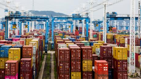 Containers are seen transported at Ningbo-Zhoushan port on August 15, 2021 in China.