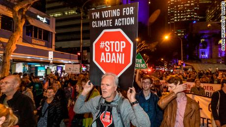 Protesters against the Adani coal mine, now named Bravus, march through the streets of Brisbane on July 5, 2019.