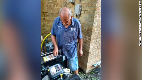 Wayne Encalarde installs a generator onto his home after Hurricane Ida to get his home based business up and running.