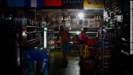 Shoppers buy supplies at a grocery store during the blackout after Hurricane Ida in New Orleans, Louisiana, on , Sept. 2, 2021.