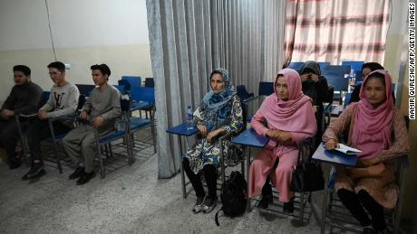 Curtains separate male and female Afghan students as new term begins under Taliban rule