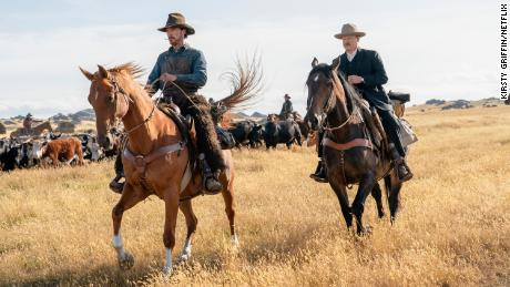 """In """"The Power of the Dog,"""" Benedict Cumberbatch (left) plays a cowboy whose repressed sexuality informs his prickly personality."""