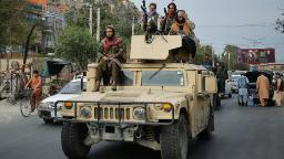 The militant group unveiled a new interim government for Afghanistan, with a top post going to a militant wanted by the US
