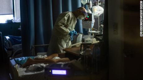 Doctor Delkhah Shahin checks on a 34 year old, unvaccinated Covid-19 patient at Providence Cedars-Sinai Tarzana Medical Center in Tarzana, California.