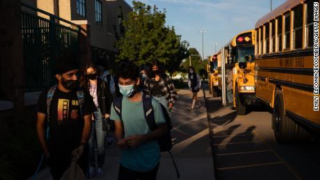Students arrive at a high school during the first day of classes in Novi, Michigan, on Tuesday.