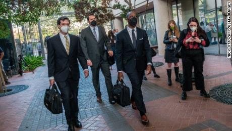 Lawyers in the fraud trial of Elizabeth Holmes, the founder and former CEO of blood testing and life sciences company Theranos, arrive for the first day of the trial, outside Federal Court in San Jose, California.