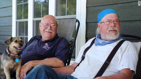 Rodebush's friend Wayland Bland, right, survived Covid-19 in 2020 and wears a mask indoors. But he still won't get vaccinated.