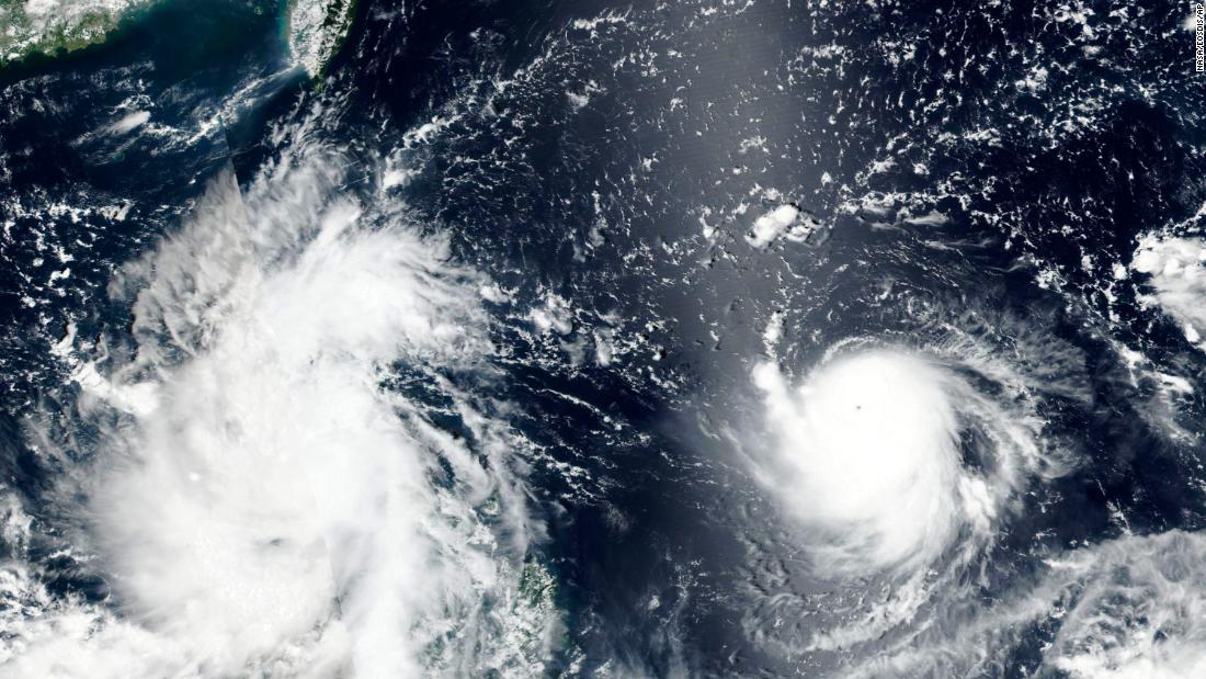 Twin tropical storms threaten flooding, mudslides in Taiwan and Vietnam