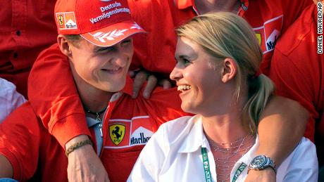 (From left) Germany's  former F1 world champion Michael Schumacher and his wife, Corinna Schumacher, smile after the Grand Prix auto race in Budapest, Hungary, August 19, 2001.