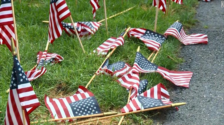 Police are investigating after flags at a 9/11 memorial were knocked over or broken