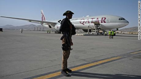 Flight lands in Qatar after Taliban cleared Americans and others to leave Afghanistan