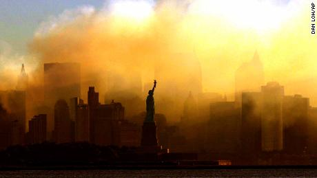 ADVANCE FOR PUBLICATION ON FRIDAY, SEPT. 10, AND THEREAFTER - FILE - In this Saturday, Sept. 15, 2001 file photo, the Statue of Liberty stands in front of a smoldering lower Manhattan at dawn, seen from Jersey City, N.J. The Sept. 11, 2001 terrorist attacks on the United States nearly 20 years ago precipitated profound changes in America and the world. (AP Photo/Dan Loh, File)