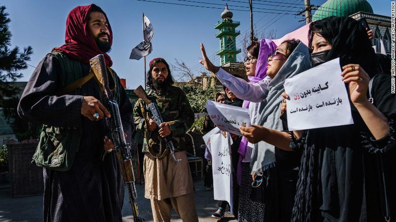 Taliban fighters use whips against Afghan women protesting the all-male interim government