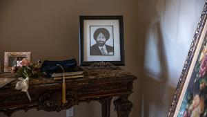 A charcoal portrait of Balbir Singh Sodhi made by a student who heard his story from his brother Rana Sodhi is displayed in Rana Sodhi's home in Mesa, Arizona, on September 5, 2021.