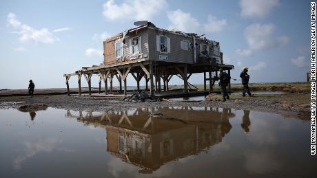 A search and rescue team checks homes in Grand Isle, Louisiana.