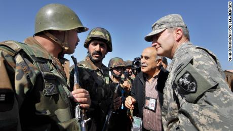 Lt. Gen. Karl Eikenberry, a commander in Afghanistan from 2005 to 2007, speaks with Afghan National Army soldiers at their remote firebase near the Pakistani border in the Barmal district of southeastern Paktika province, in October 2006.