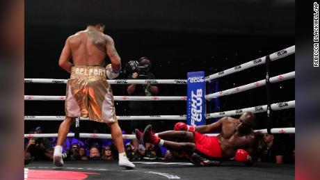 Belfort knocks down Holyfield.