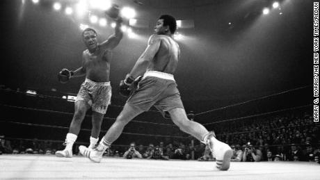 """Muhammad Ali evades a punch from Joe Frazier during """"The Fight of the Century"""" at Madison Square Garden in New York, March 8, 1971."""