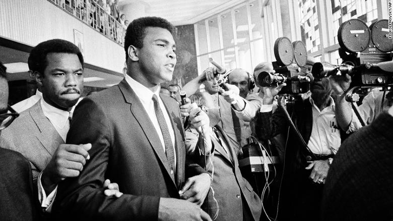 Muhammad Ali leaving the Federal Building in Houston on June 19, 1967 during his trial for refusing to be inducted into the Armed Services.