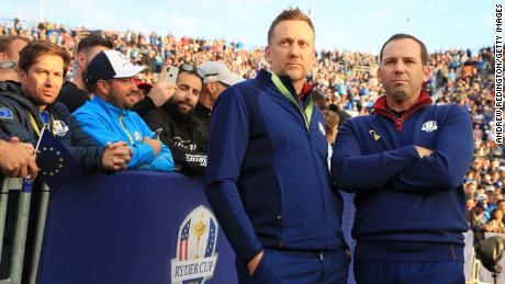 Poulter and Garcia stand on the first tee during the morning fourball matches of the 2018 Ryder Cup.