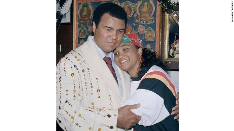 """Muhammad Ali with his daughter Maryum """"May May"""" Ali in 1988, wearing the boxing robe gifted by Elvis Presely that he would donate to New York's Hard Rock Café."""