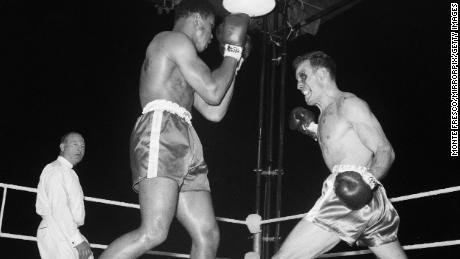 Cassius Clay fights Henry Cooper at Wembley Stadium, London on June 18, 1963.