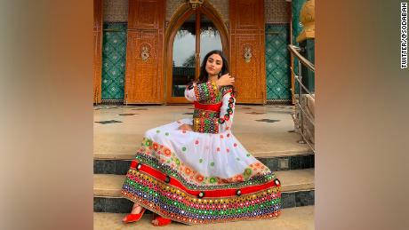 Afghan women share photos of dresses to protest Taliban mandate for black hijab