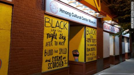 Before the vandalism, the front of the cultural center had a new sign and bright yellow frontage.