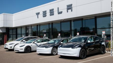 Cars at the charging stations of a Tesla dealership in Maplewood, Minnesota on June 13, 2021.
