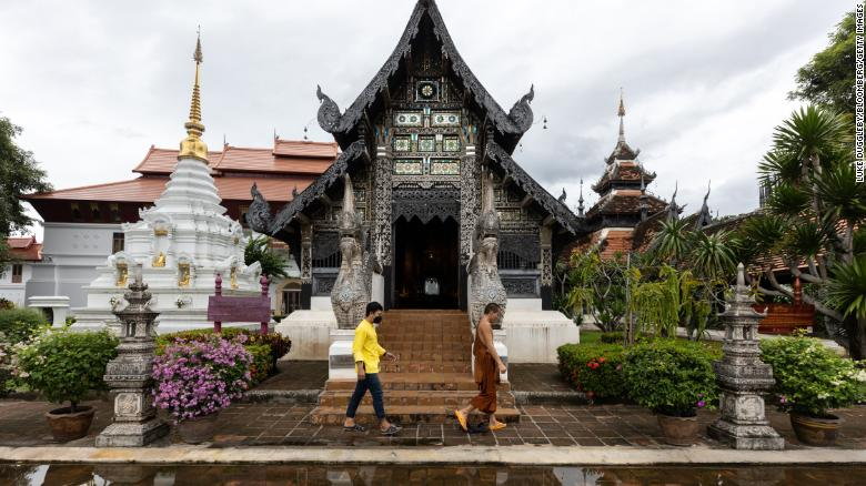 A monk walks through a near empty Wat Chedi Luang in Chiang Mai, Thailand, on September 9, 2021.