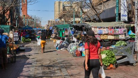 Shoppers in a market in the central business district of Pretoria, South Africa, on September 14, 2021.