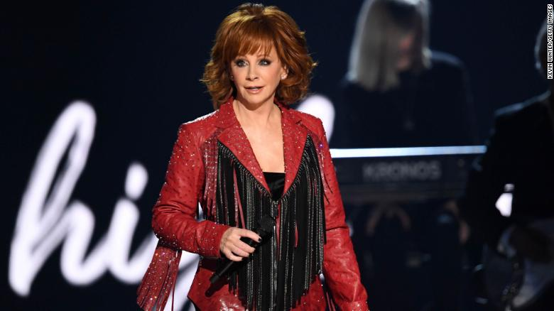 Country star Reba McEntire has to be rescued from a second-story window after stairs collapse in historic Oklahoma building