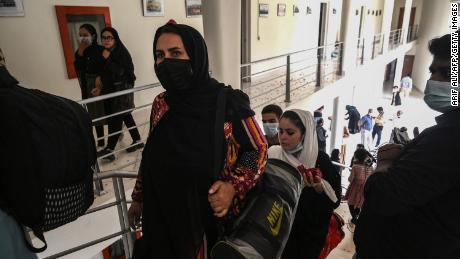 Members of Afghanistan's national girls football team arrive at the PFF in Lahore.